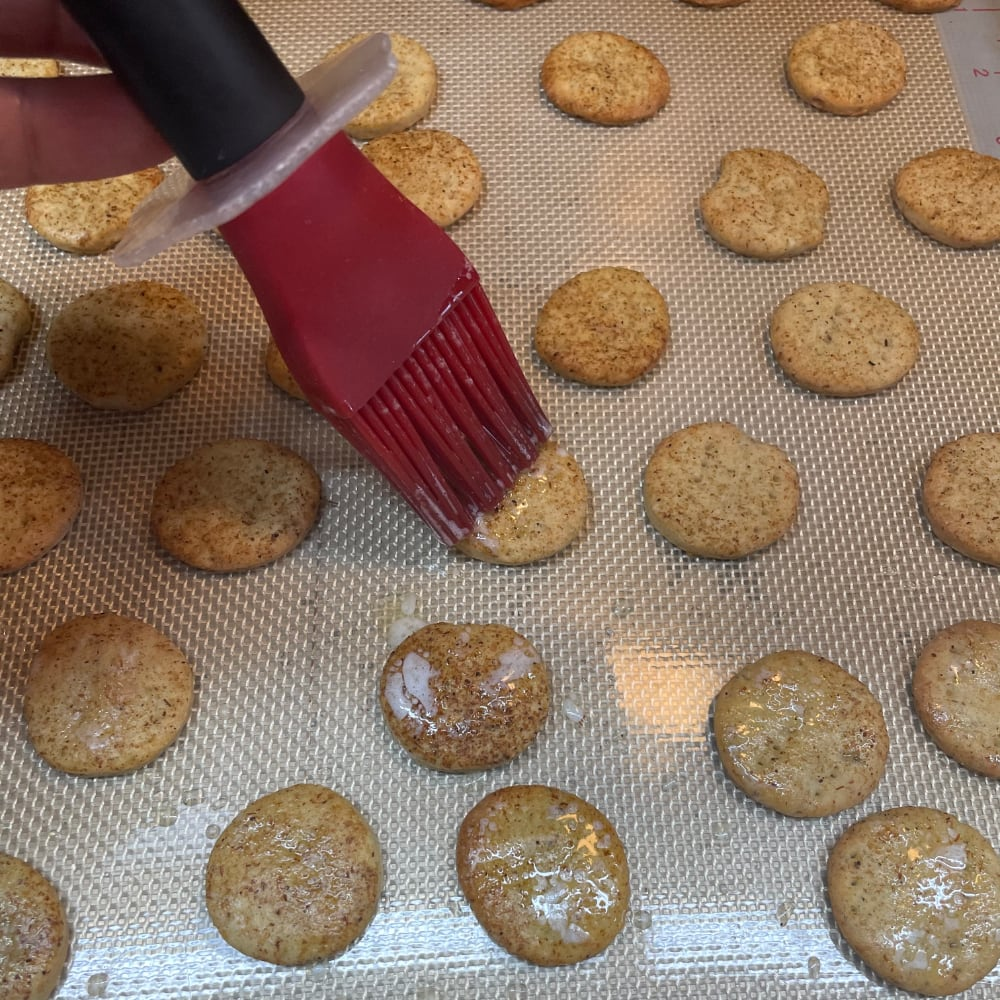Brush melted butter onto your butter crackers with mushroom powder